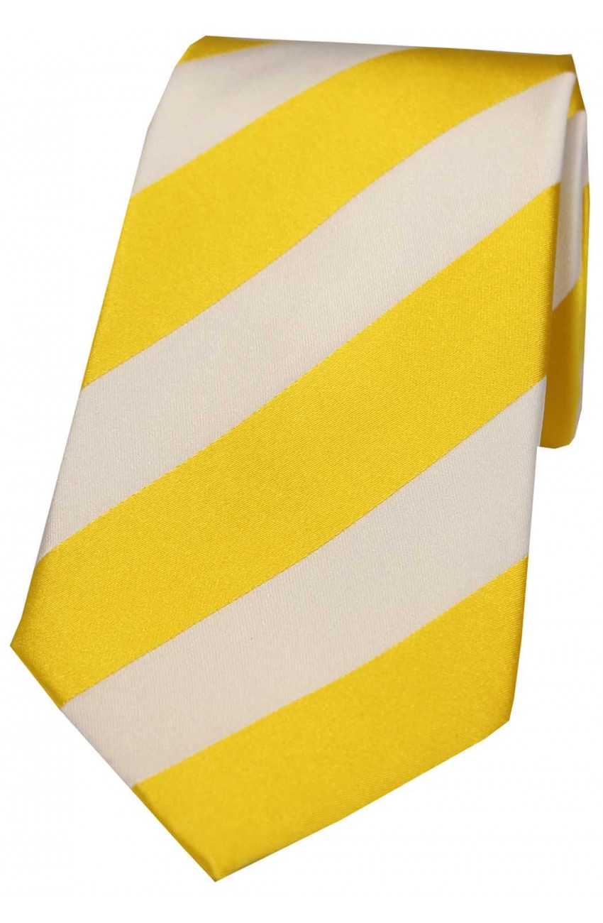 Gold and white striped tie suggest